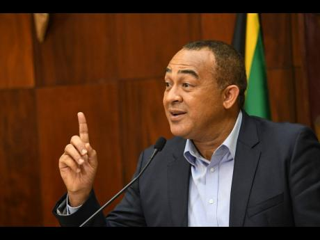 Dr Christopher Tufton, minister of health and wellness, addresses a press conference on COVID-19 at Jamaica House on Monday. He hosted a digital briefing on Zoom yesterday.