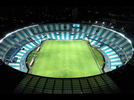 Peru's Alianza Lima and Argentina's Racing Club play a Copa Libertadores match at Estadio Presidente Peron in Buenos Aires, Argentina, on Thursday, March 12, 2020. The match was played in an empty, closed door stadium as part of the government's measures to contain transmission of the novel coronavirus.