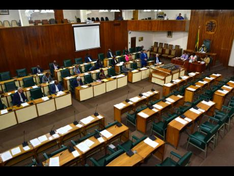 Prime Minister Andrew Holness makes a statement to Parliament during a hastily arranged sitting of the House of Representatives on Tuesday. The Opposition said they were informed too late and had counter proposed a Wednesday morning sitting.