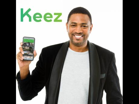 Ajani Williams-Harris of SciFi Studios displays the Keez App.