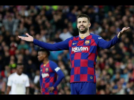 Barcelona's Gerard Pique reacts during the Spanish La Liga match between Real Madrid and Barcelona at the Santiago Bernabeu stadium in Madrid, Spain, Sunday, March 1, 2020.