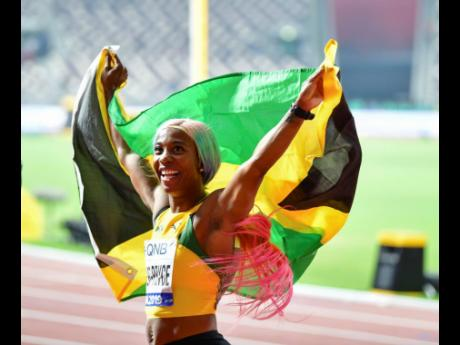 Shelly-Ann Fraser-Pryce celebrates after her win in the women's 100m final at the 2019 World Athletics Championships held at the Khalifa International Stadium in Doha, Qatar. Fraser-Pryce clocked an impressive 10.71 seconds.