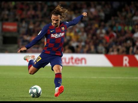 Barcelona forward Antoine Griezmann takes a shot on during their LaLiga game against Valencia at Estadio Camp Nou in Barcelona, Spain on Saturday, September 14, 2019.