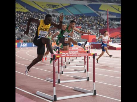 Jamaica's Kemar Mowatt competes in Heat One of the men's 400m hurdles at the World Athletics Championships in Doha, Qatar on Friday, September 27, 2019.