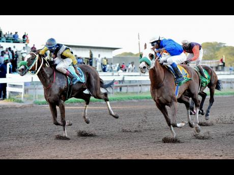 PRINCE CHARLES (right), ridden by Reyan Lewis, wins the Ash Wednesday Trophy ahead of WARTIME, ridden by Raddesh Roman at Caymanas Park on Wednesday, February 26.
