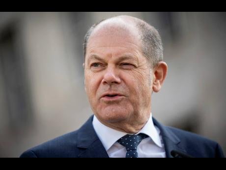 German Finance Minister Olaf Scholz abrief the media after Eurogroup negotiations in front of the finance ministry in Berlin, Germany, Wednesday, April 8, 2020. (Michael Kappeler/dpa via AP)