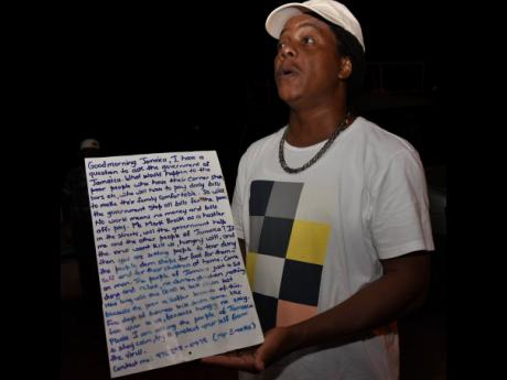 Mark Brooks, a self-proclaimed 'hustler' from St Elizabeth, displays a letter addressed to the prime minister about concerns over social and economic effects of a lockdown of the State.