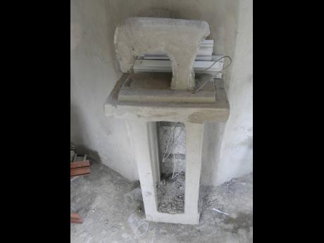 The unfinished sewing machine in the monumental tomb in Annotto Beach Cemetery in St Mary.