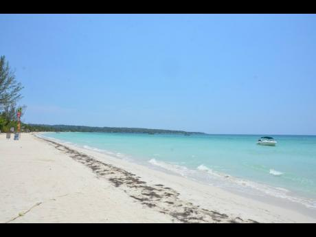 The legendary Negril beach is now deserted as far as the eye can see.
