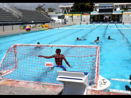 Members of the Jamaican water polo team take part in a practice session at the National Aquatic Centre.