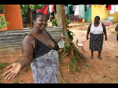 Antonette York (left) and Mavis Lobban, residents of Zion Hill in St Catherine, speaking about the St Catherine lockdown on Sunday.