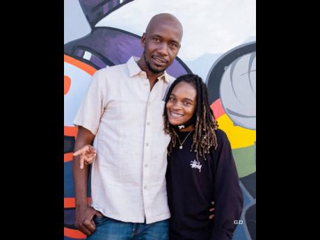 Comar 'Frankie Music' Campbell, producer of Koffee's 'Raggamuffin', with the artiste at his studio recently.