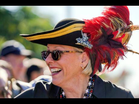 In this January 25, 2020 file photo, Tampa Mayor Jane Castor smiles while greeting people during the Gasparilla Parade of Pirates in Tampa, Florida. Castor is poking fun at last week's attention-grabbing incident involving NFL superstar Tom Brady.