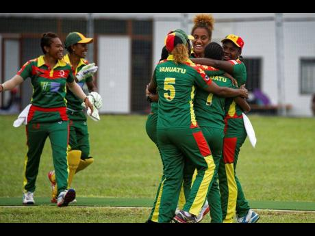 In this May 2019 photo, provided by the Vanuatu Cricket Association, players celebrate during a women's cricket match in Port Vila, Vanuatu.