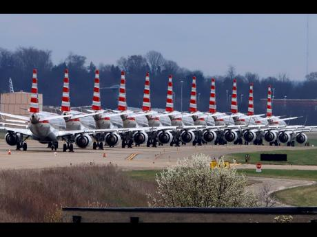 AP In this March 31, 2020 file photo, American Airlines planes stored at Pittsburgh International Airport sit idle on a closed taxiway.