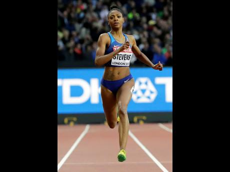 In this August 8, 2017, file photo, United States' Deajah Stevens races in a women's 200m first round heat during the World Athletics Championships in London.