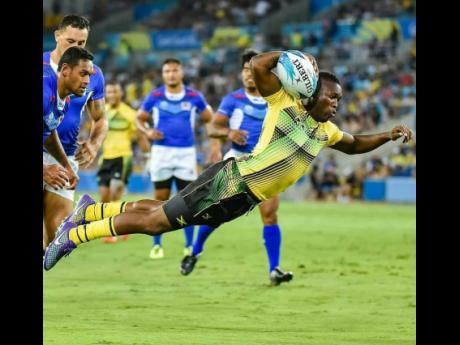 Jamaica Crocs' Reinhardo Richards scoring his team's lone try against Samoa in Commonwealth Games Rugby Sevens action on the Gold Coast, Australia, on Saturday, April 14, 2018.  File