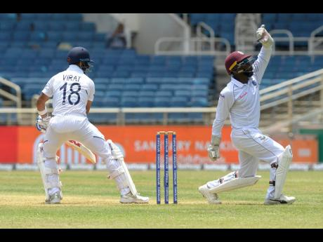Windies wicketkeeper Jahmar Hamilton  makes an appeal to the umpire against India captain Virat Kohli in front of empty stands at Sabina Park in Kingston during day one of their second Test match on Friday, August 30, 2019. Although the lack of turnout at the time was not forced because of restrictions on gathering, many sporting events, including the upcoming Test between the Windies and hosts England, could have a similar look when they resume, because of safeguards against the spread of COVID-19.