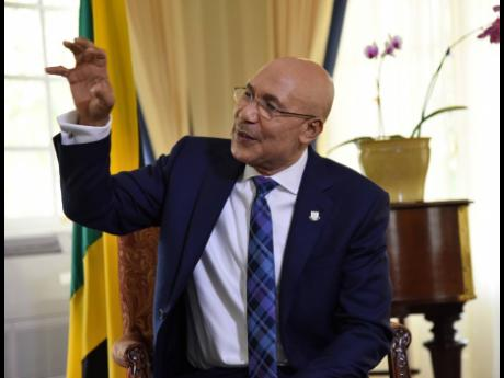 Governor General Sir Patrick Allen gestures during an interview at King's House on Friday, May 8.