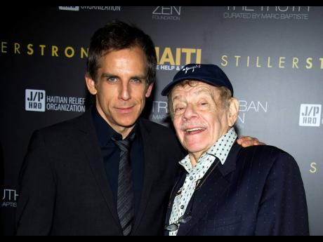 In this February 11, 2011 photo, Ben Stiller (left) and his father, Jerry Stiller, arrive at the Help Haiti benefit honouring Sean Penn, hosted by the Stiller Foundation and The J/P Haitian Relief Organization, in New York.