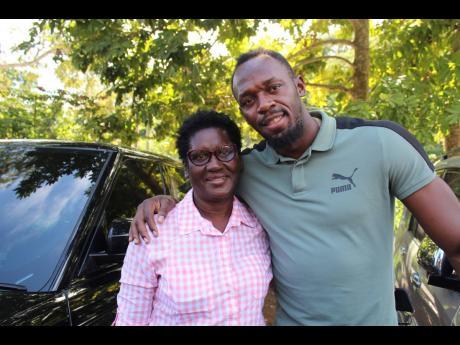 Jennifer Bolt and her son, Usain, share a smile.