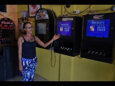 Audrey Blidgen, operator of Sun Rise Pub on Penwood Road in Waterhouse, explains how social-distancing rules will complicate the use of slot machines at her saloon. Bars were ordered closed by the Government on March 18 to help curb the spread of the new coronavirus.