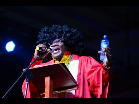 Cordel Green, executive director, Broadcasting Commission, performs a skit at the Powerful Men and Women Perform for Charity concert held at the National Indoor Sports Centre, June 10, 2018.