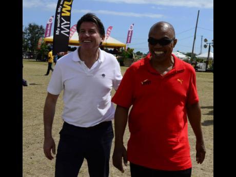 World Athletics President Sebastian Coe (left) and Dr Warren Blake, JAAA president.