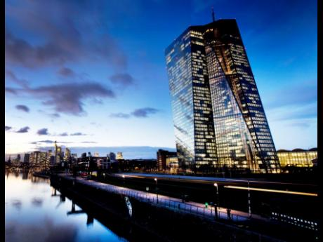 AP Photos  The European Central Bank sits next to the river Main in Frankfurt, Germany.