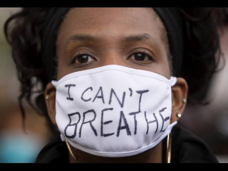 A woman attends a demonstration calling for justice for George Floyd.