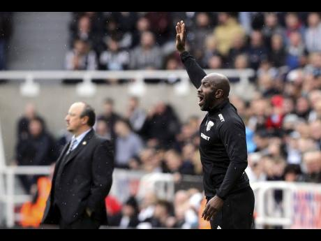 Former national defender Darren Moore, pictured here, is one of just a small number of black men to have managed an English Premier League club, having worked at West Bromwich Albion.