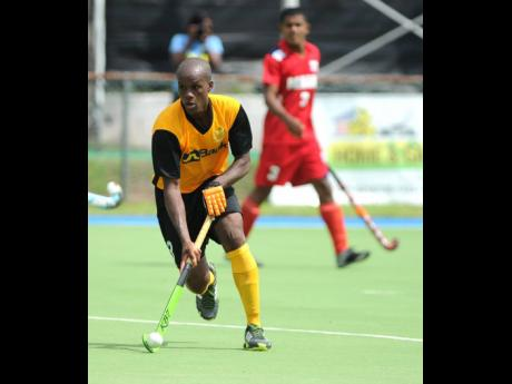 Jamaica's senior men's hockey team in action during a CAC Games qualifier at the Mona Hockey Field on Sunday, November 5, 2017.