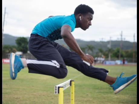 Jamaica College athlete Jahiem Stern going through hurdling drills at the Ashenheim Stadium on Thursday, February 20.