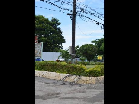 Dangling and downed cables on Jimmy Cliff Boulevard.