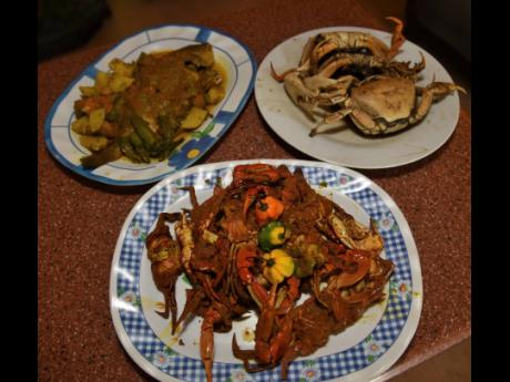 From left (back row) : D85 Lounge presents its curried fish, boiled crab and curried sea crab (in front).