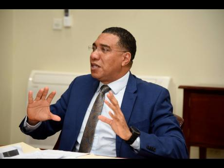 Prime Minister of Jamaica Andrew Holness speaking yesterday at a Zoom meeting with members of the Private Sector Organisation of Jamaica and the Jamaica Manufacturers and Exporters' Association, along with other stakeholders to discuss the way forward i