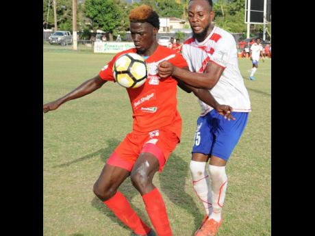 In this file photo from March 2017, Shamar Nicholson (left), then of Boys' Town, takes control of the ball while under pressure from Maverley Hughenden's Andrew Whyte during a Red Stripe Premier League match at the Barbican Field.