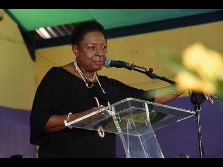 Minister of Culture, Gender, Entertainment and Sport, Olivia Grange, pays tribute to Bobby Digital .