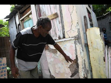 Nigel Townsend expressing concern over the structural soundness of his dwelling to The Gleaner on June 19. The house has been demolished by community members, who are now erecting a new home for Townsend.