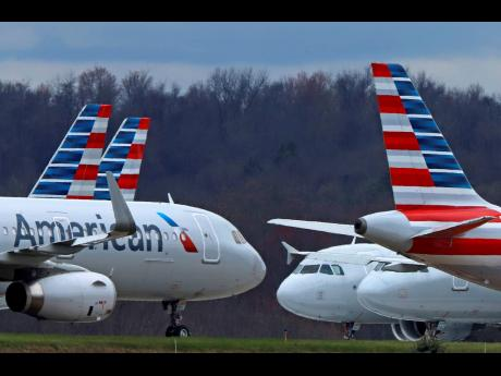 AP In this March 31, 2020 photo, American Airlines planes are parked at Pittsburgh International Airport in Imperial, Pennsylvania.