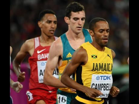 In this file photo from August 2017, Jamaica's Kemoy Campbell (right) takes part in heat two of the men's 5000m race at the World Athletics Championships in London, England.