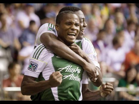 Former Portland Timbers' defender Alvas Powell (foreground) celebrates with teammate Fanendo Adi after scoring against the Vancouver Whitecaps in a MLS match in 2014. Powell now represents Inter Miami.