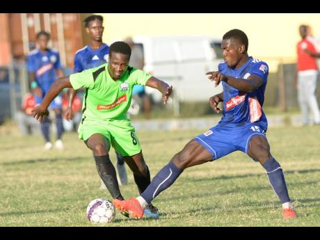 Mount Pleasant's Kevaughn Isaacs (right) gets a toe to the ball ahead of Molynes United's Tyrique Wilson during a Red Stripe Premier League match at the Constant Spring Sports Complex on Sunday, December 15, 2019.