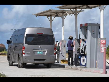 A vehicle being fuelled at the Fuel Deals Express depot in Kingston, on Thursday, July 9.