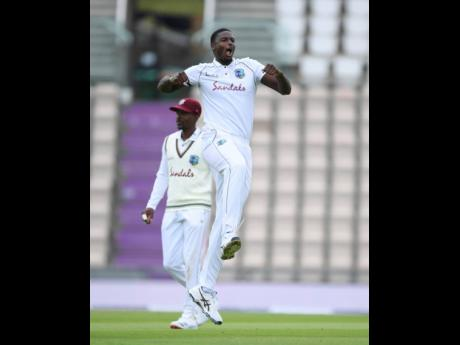 Windies' captain Jason Holder celebrates the dismissal of England's Jos Buttler during the second day of the first cricket Test match at the Ageas Bowl in Southampton, England, yesterday.