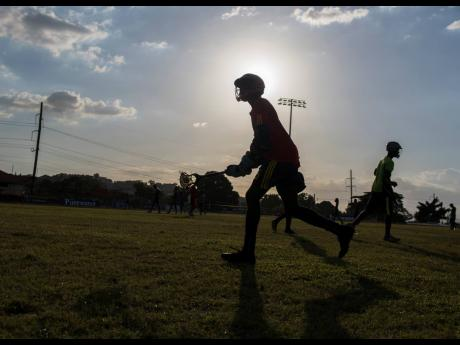 Members of the Jamaica College (JC) lacrosse team training at the Jamaica College Ashenheim Stadium earlier this year. JC are appealing a decision by the Jamaica Lacrosse Association to hand the high school title to fellow finalists Kingston College after