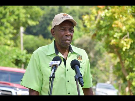 JC Hutchinson, Minister without Portfolio in the Ministry of Industry, Commerce, Agriculture and Fisheries.