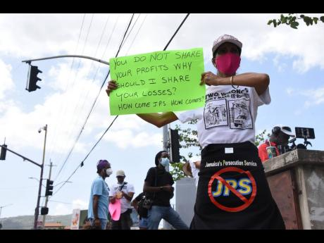 One of the protesters who on Saturday turned out to voice objection to what they saw as unusually high electricity bills and to speak out against the JPS charging paying customers for losses due to theft.
