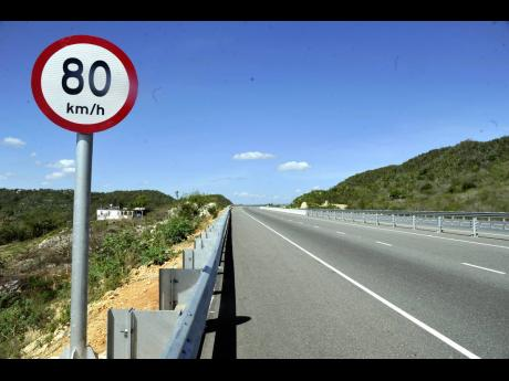 A speed limit sign along the Edward Seaga Highway.