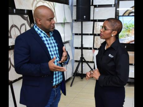 Dwight Crawford, chairman, Build Expo & Conference, and Marcia McLaughlin, VP, marketing, Hardware & Lumber, at an expo in 2018.